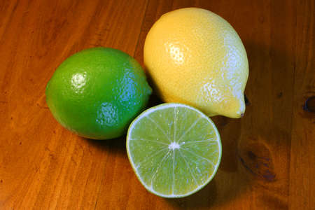 Lemons and limes on wooden table Stock Photo