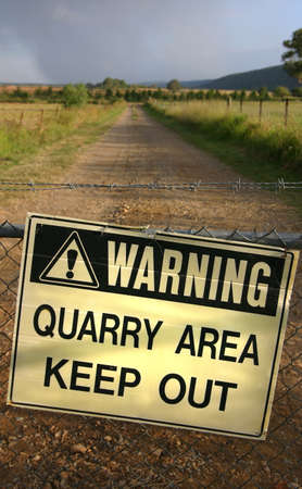 Razor Wire Gate with sign warning of hazardous quarry area, Keep Out Stock Photo - 1536240