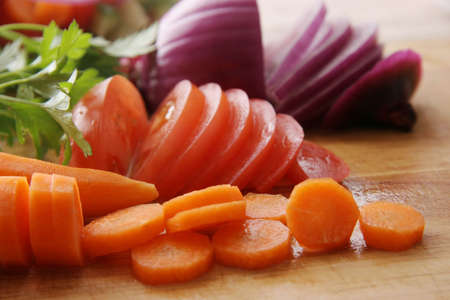 Cut vegetables on a wooden board. Stock Photo - 597180