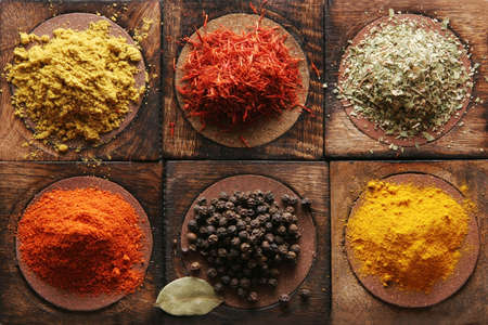 spicery: Different tipes of spice on wooden boards. Stock Photo