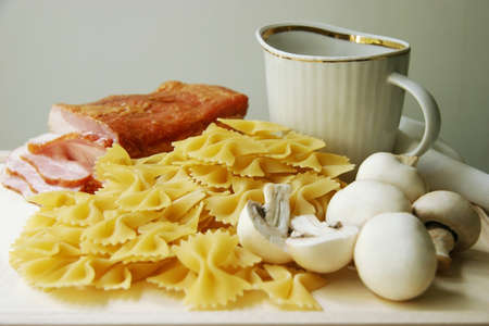 Ingredients for pasta on a wooden board. photo