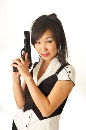 The Asian girl with a pistol in her hands photo