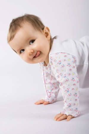 One year old cute caucasian baby girl making faces. Stock Photo - 3003498