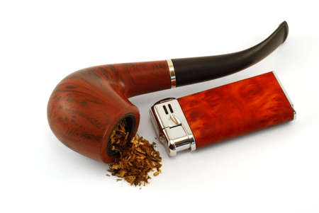 The tobacco-pipe and lighter are photographed close up on a white background Stock Photo