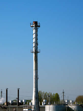 energies: The factory chimney photographed on a background of the blue sky Stock Photo