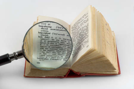 consider: The pocket dictionary consider under a magnifier