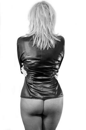 The woman dressed in a black leather jacket, photographed behind  Stock Photo