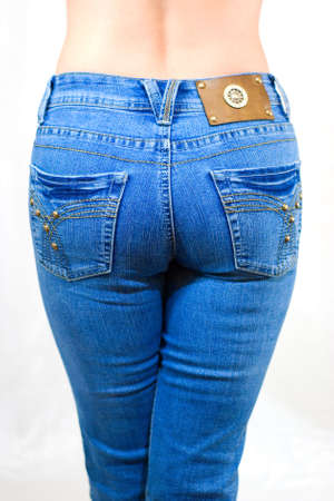 Female nates, hardly fitted by jeans Stock Photo