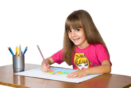 The girl in a red blouse draws color pencils