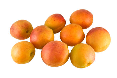Nine apricot are photographed on a white background