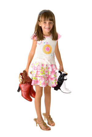 The little girl trying on footwear a big size  Stock Photo