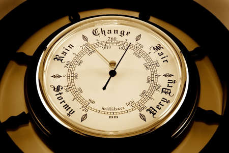 The dial of a barometer is photographed close-up