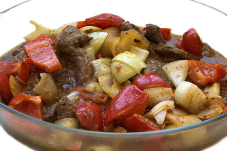 Bowl of onions, beef and peppers prepared for a casserole photo