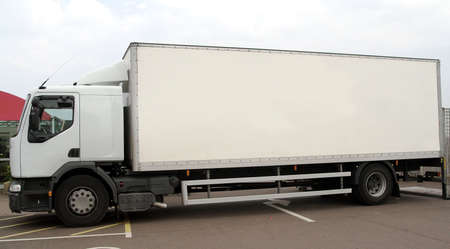 Large white articulated lorry on a parking lot Stock Photo