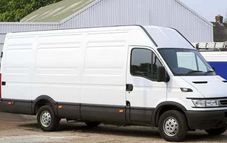 New white Van on garage forecourt, all clean and shiny bright ! Stock Photo