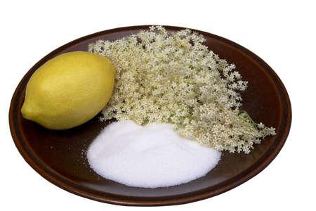 Elderflower Sorbet ingredients, elderflowers, lemon (for the juice) and sugar on a brown plate Stock Photo - 963446