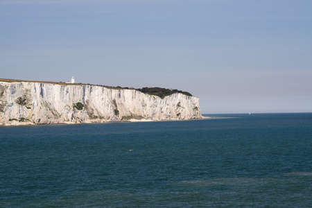 Spit at end of the White Cliffs of Dover, seen in high summer, blue skies and blue sea Stock Photo