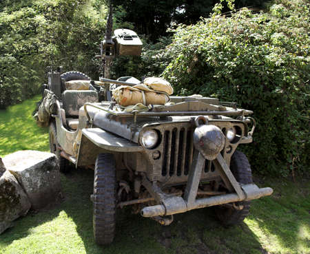 World War II army vehicle with mounted gun and gear slung over its back Stock Photo