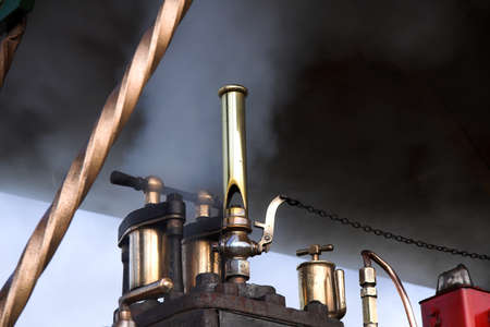 traction engine: Steam whistle and smoke under the roof of a vintage traction engine Stock Photo