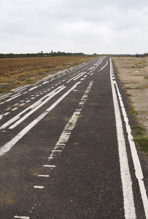 going nowhere: Disused Airfield - runway going no-where, confusing white lines