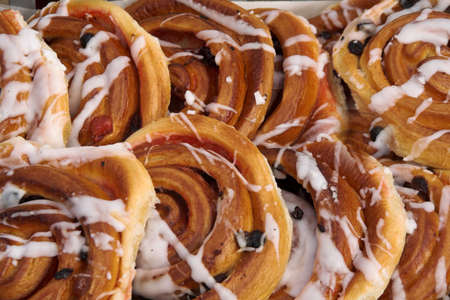 Sugared Danish pastries with currants and icing