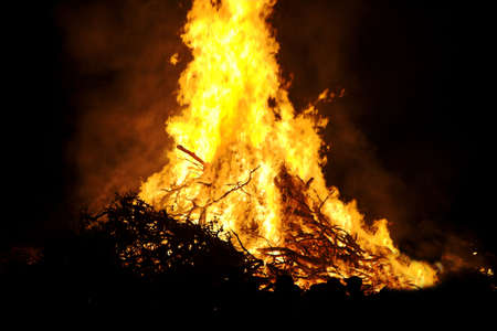 guy fawkes night: Bonfire celebrating Guy Fawkes Night in an English Village Stock Photo