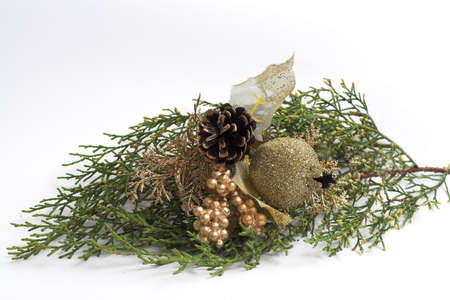 Twigs of evergreen larch with golden Christmas decorations Stock Photo - 2130432