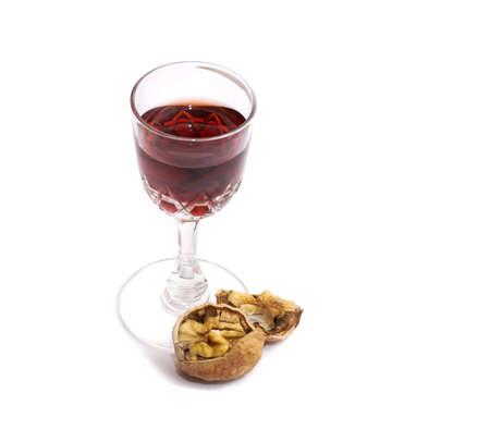 tawny: Glass of tawny port with a broken walnut Stock Photo