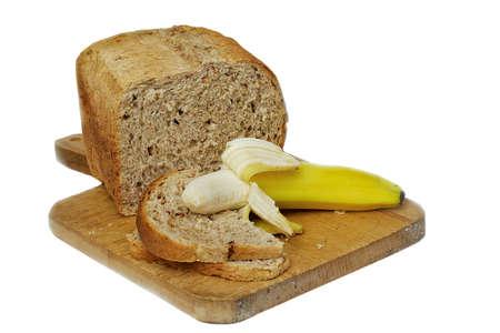 Granary Bread with a banana, ready to make sandwiches Stock Photo - 2547374