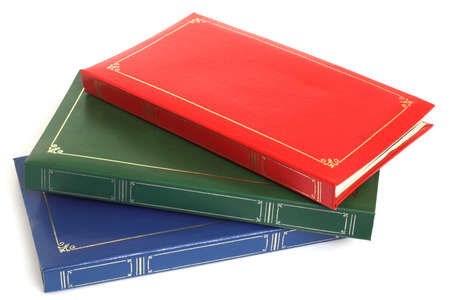 souvenirs: Pile of blue, green red photo albums - the front is available for design Stock Photo