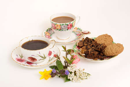 Coffee, cake and biscuits set for a genteel tea-party Stock Photo - 2660344