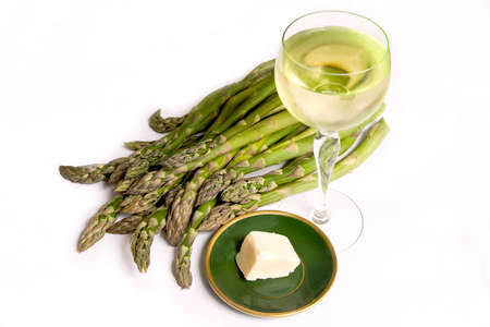 Asparagus, butter and a glass of wine, healthy and delicious
