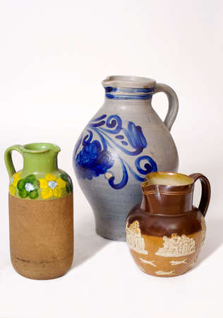 Collection of jugs in different styles, shapes and materials photo