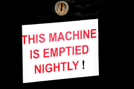implication: A warning on a parking meter - dont try to break in