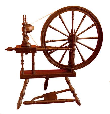 Slightly chipped, elderly spinning wheel, still in regular use Stock Photo