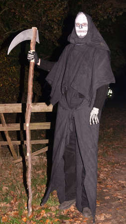 portent: Man dressed as the Grim Reaper to put fear into hearts