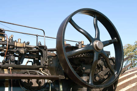 oiled: Steam engine section with part of motor with wheel Stock Photo