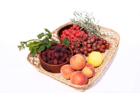 various fresh fruit in bowls in a basket photo