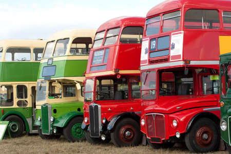 Line-up of old fashioned, ancient, double decker buses Stock Photo