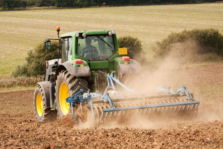 harrow: Dust following behind disc harrow on the Sussex Downs