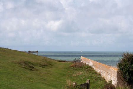 Sunshine & shadow over sea & wall on the South Downs photo
