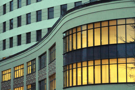 to hasten: curved building Stock Photo