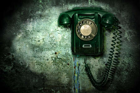 antique booth: Old phone on the destroyed wall Stock Photo
