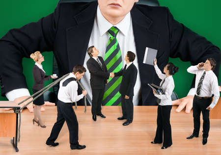 subservience: Boss and business team on green background