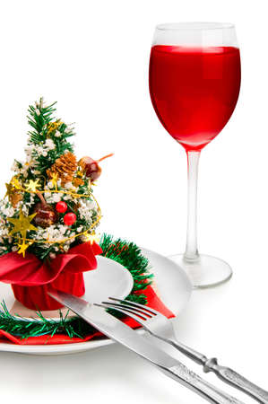 glass of red wine and Christmas decoration, isolated on white background photo