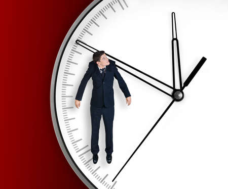 Businessman hangs on an arrow of clock, isolated on red background Stock Photo