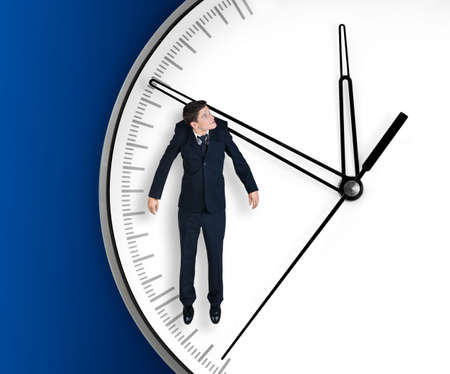 Businessman hangs on an arrow of clock, isolated on blue background