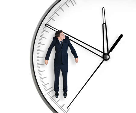crisis management: Businessman hangs on an arrow of clock, isolated on white background