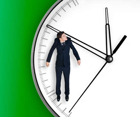 hangs: Businessman hangs on an arrow of clock, isolated on green background
