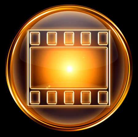 video icon gold, isolated on black background Stock Photo